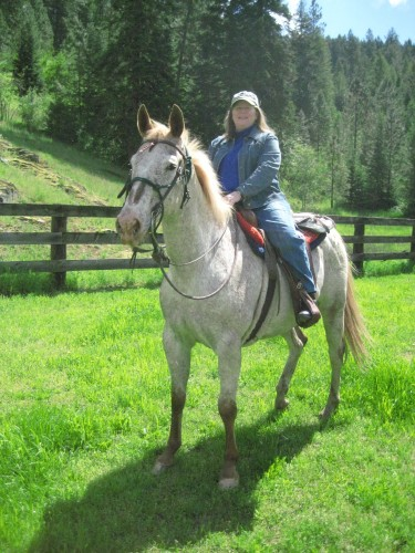 Nancy D. Brown and Gunner on a horseback riding vacation at Red Horse Mountain Ranch