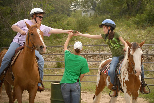 Mother and daughter bond on a horseback riding vacation at Sugar & Spice Ranch in Bandera, Texas