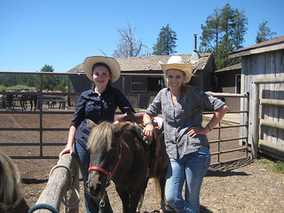 Alexa Shuster & Sophia Carter take children on pony rides at Sunriver Stables