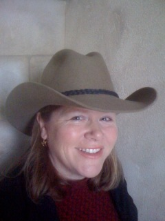 Nancy D. Brown ready for a horseback riding vacation