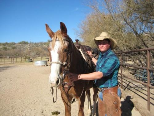 Chris Vassar saddles Mac for a horseback riding vacation