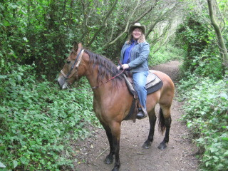 Nancy and Thelma on a horseback riding vacation in the forest of Half Moon Bay, California