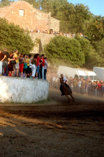 Horse and rider round the turn during S'Ardia of Sedilo horse race in Italy