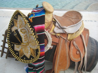 Mexican vaqueros prepare for a horseback riding vacation in Los Cabos