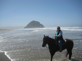 Travel Writer Nancy D. Brown on a horseback riding vacation with Morro Rock in the background