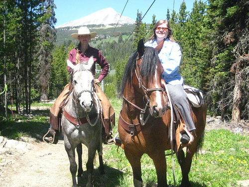 Spanish Peaks Wrangler Haven Leavitt and Travel Writer Nancy D. Brown on a Big Sky, Montana horseback riding vacation with Lone Peak in the distance