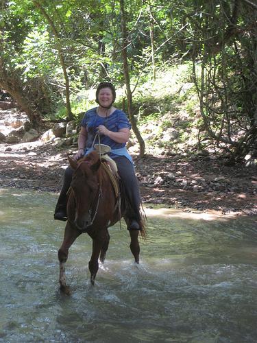 Nancy crossing Las Palmas River on Zarape - magical horseback riding vacation