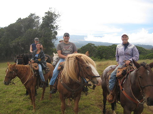 Riders from New York join Wrangler Marlene (right) on a horseback riding vacation at Piiholo Ranch in Maui, Hawaii
