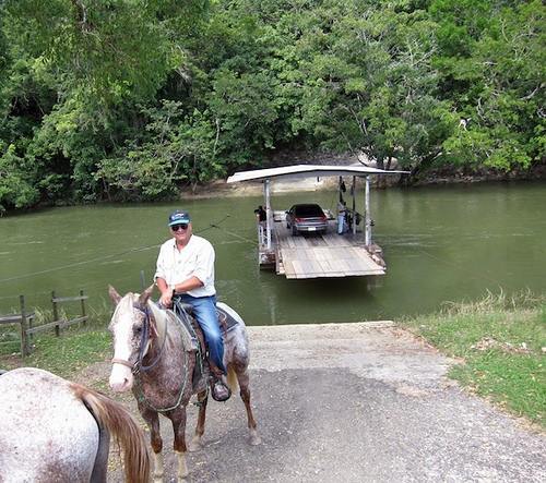 Taking the ferry to upcountry Cayo District of western Belize on a horseback riding vacation