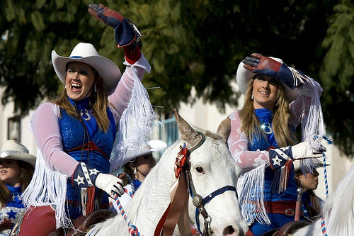 Have you ridden a parade horse during a horseback riding vacation? These cowgirls look like they are enjoying their ride in the Tournament of Poses Parade.