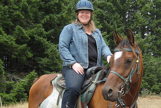 """Nancy D. Brown riding horseback"""