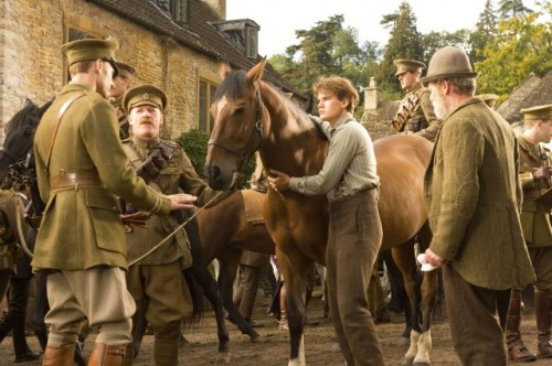 Albert Narracott (Jeremy Irvine) with Joey in War Horse movie, DreamWorks photo