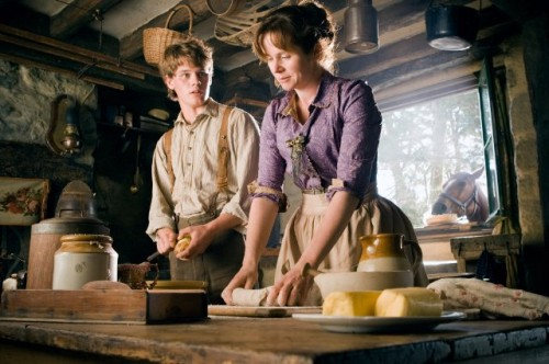 Albert Narracott (Jeremy Irvine) with his mother Rose and horse Joey in the background.