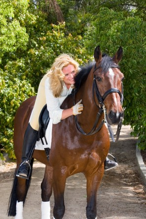 (Terri Miller/Handout) - Ann Romney with her horse, Super Hit, in a 2006 photo.