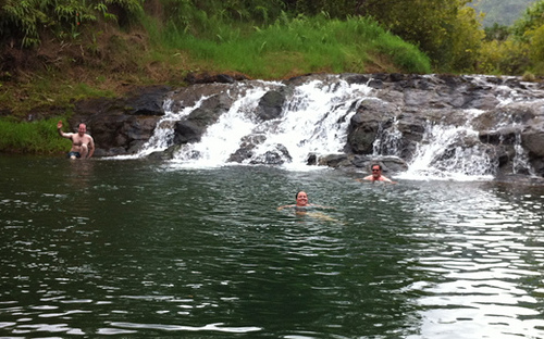 Swim at Silver Falls during a horseback riding vacation in Kilauea, Hawaii