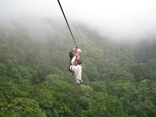 Jill Breman ziplines in the Monteverde rainforest of Costa Rica