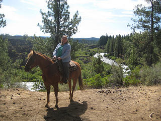 On a horseback riding vacation in Bend, Oregon wearing ExOfficio BugsAway Halo shirt