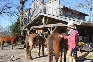 Larry Butler prepares for a horseback riding vacation at Seventy-Four Ranch