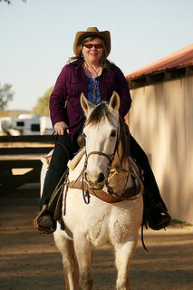 """Nancy D. Brown on horseback"""