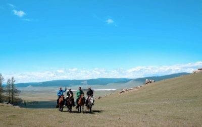 horseback riding in mongolia, riding by khuvsgul lake, mongolia, deann rebello